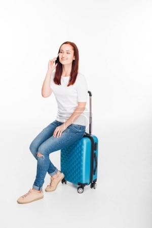 viaggiatore con bagaglio e smartpho...